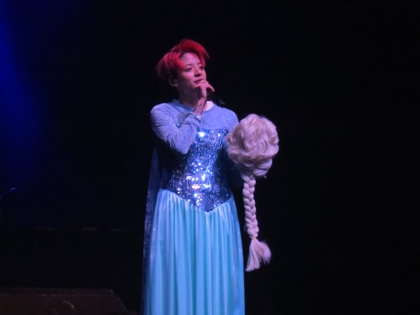 "Amber sings ""Let it go"" from the Disney movie ""Frozen"" as Elsa. However, she warmed her audience's hearts with her vocals and kind words."